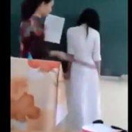 【衝撃】アオザイ着てる女子高生のお尻を棒でスパンキングする簡単なお仕事がこちらw