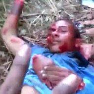 首と手首を切断された男性の死体にビンタをしてカメラに向かってピースするヤバい奴ら…