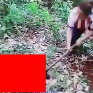 斧で人の死体を解体していくガタイのいい女性